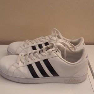 White and black striped Adidas superstar sneakers